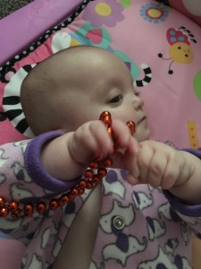 Paige loves to play with beads. They really get her attention and are easy to hold.